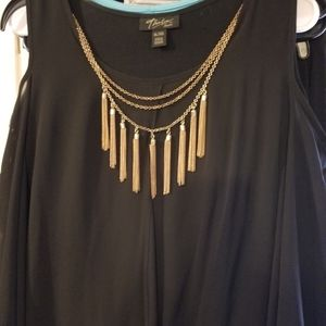 Flowing blouse with necklace